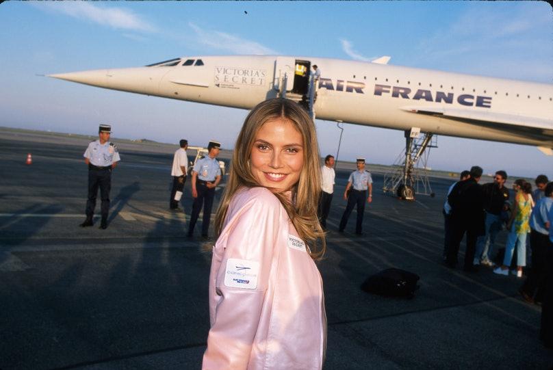 Heidi Klum in front of a Concorde jet