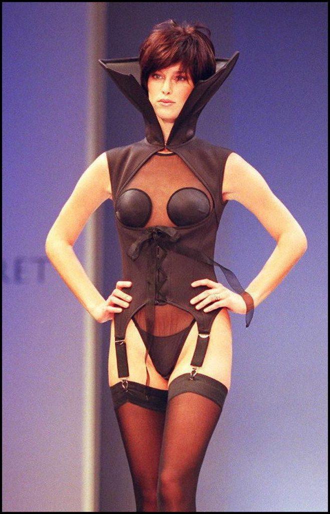 A model wearing a black scuba-diving femme fatale corset
